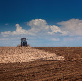 Agricultural Lanscape - Tractor working on the field Royalty Free Stock Photo