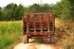 Agricultural machine on rural road Royalty Free Stock Photos