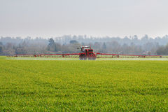 Agricultural Machine spraying crops Royalty Free Stock Photo