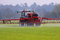 Agricultural Machine spraying crops. Crop spraying machine at work in an English field Royalty Free Stock Image