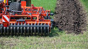 Agricultural machinery ready to cultivate. The fields stock photo