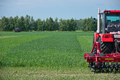 Agricultural machinery ready to cultivate. The fields royalty free stock photos