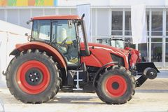 Agricultural machinery, tractor with the cultivator at the exhibition. Agribusiness concept Stock Photography
