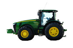 Agricultural machinery tractor. Powerful motor vehicle with large rear wheels, used chiefly on farms for hauling equipment and trailers. Isolated, white royalty free stock photo