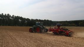 Agricultural machinery - tractors, seeders, sprayers and cultivators work in the field Stock Photo