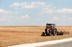Agricultural machinery, work in the field. Stock Photos