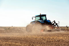Agricultural machinery, work in the field. Royalty Free Stock Photos