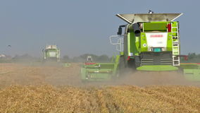 Agricultural machinery in the work of the harvest stock video footage