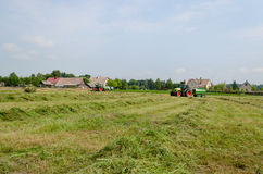 Agricultural machines prepare hay animal fodder Stock Photos