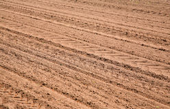 Agricultural ploughed field pattern background Stock Photo