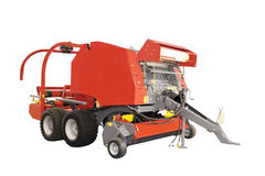 Agricultural round baler. Isolated under the white background royalty free stock photography
