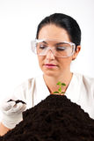 Agricultural scientist woman. Check soil and smile in a laboratory,check also my collection Scientists people Stock Photo