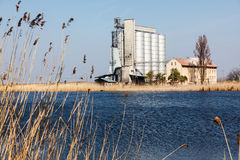 Agricultural silo. Agricultural silo on the coast close to the lake Royalty Free Stock Photos