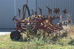 Agricultural slurry injector trailer. For injecting slurry into the soil on fields and then plow the slurry under the soil. The plastic hoses used to transport Royalty Free Stock Images
