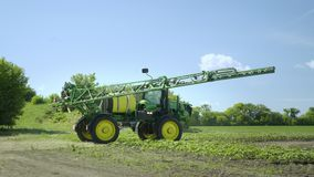 Agricultural sprayer getting ready to work on farming field. Spraying machine stock video footage