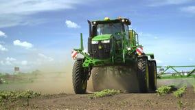 Agricultural sprayer irrigating farming field. Spraying machine stock footage
