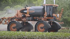 Agricultural sprayer moving on agricultural field. Farming equipment stock video footage