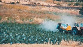 Tractor sprays water or fertilizer irrigation. Agricultural Sprayer - Tractor sprays water or fertilizer, irrigation stock footage