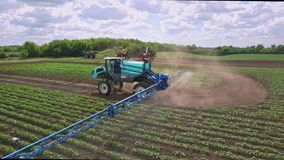 Agricultural sprayer watering fertilizer on farming field. Agricultural industry stock video