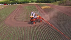 Agricultural sprayer watering plant on farming field. Farming industry stock video