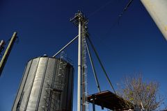 Agricultural steel grain silos, tubes and pipes used for farming. In rural west Texas, USA royalty free stock photos