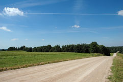Agricultural summer landscape with road Royalty Free Stock Photography
