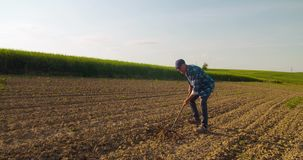 Agricultural Tool Is Hoeing Field. Lockdown shot of hoe is been used for breaking soil in farm