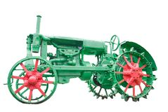 Agricultural tractor. Emblem - an agricultural tractor of past times Stock Photography