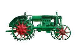 Agricultural tractor. Emblem - an agricultural tractor of past times Stock Photo