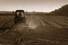 Agricultural tractor cultivating land Royalty Free Stock Photo
