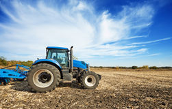 Agricultural tractor in the field Royalty Free Stock Image