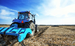 Agricultural tractor in the field Stock Image
