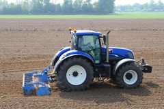 Farmer in tractor plows the fields, Tricht / Geldermalsen, Betuwe, Netherlands. Agricultural machinery plows the fields at the farmland, Geldermalsen, Betuwe Royalty Free Stock Image