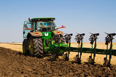 Agricultural tractor plowing a field Royalty Free Stock Photos