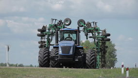 An agricultural tractor, plowing a field before sowing, stock video footage