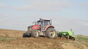 Agricultural tractor sowing and cultivating vineyard field stock video footage