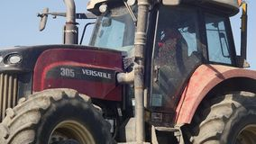 Agricultural tractor sowing and cultivating vineyard field stock footage