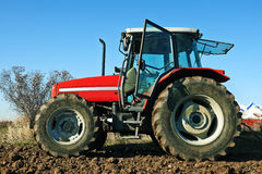 Agricultural tractor sowing seeds Stock Photos