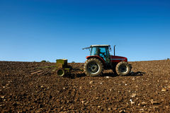 Agricultural tractor sowing seeds Stock Images