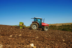 Agricultural tractor sowing seeds Stock Image