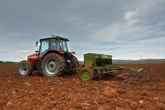 Agricultural tractor sowing seeds Royalty Free Stock Photos