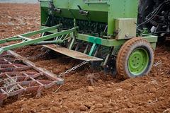 Agricultural tractor sowing seeds Royalty Free Stock Photography