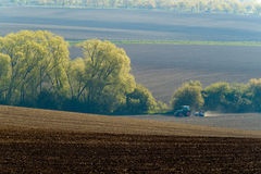 Agricultural tractor working Royalty Free Stock Photos