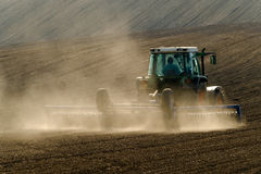 Agricultural tractor working Stock Photo