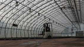 Agricultural. Tractors in the big greenhouse stock video