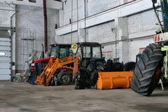 The agricultural tractors in the shop preparing for planting royalty free stock image