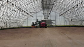 Agricultural. Two tractors in the big greenhouse stock video
