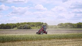Agricultural vehicle. Farmer on tractor. Farming equipment. Agricultural machine stock footage