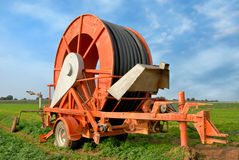 Agricultural watering equipment. Outdoor shot of an agricultural hose roller on a truck royalty free stock image