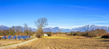 Agricultural winter panorama . With solar power station. Royalty Free Stock Photos